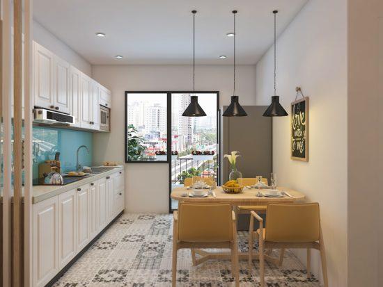 Căn bếp nhỏ luôn tràn ngập ánh sáng nhờ cửa kính lớn